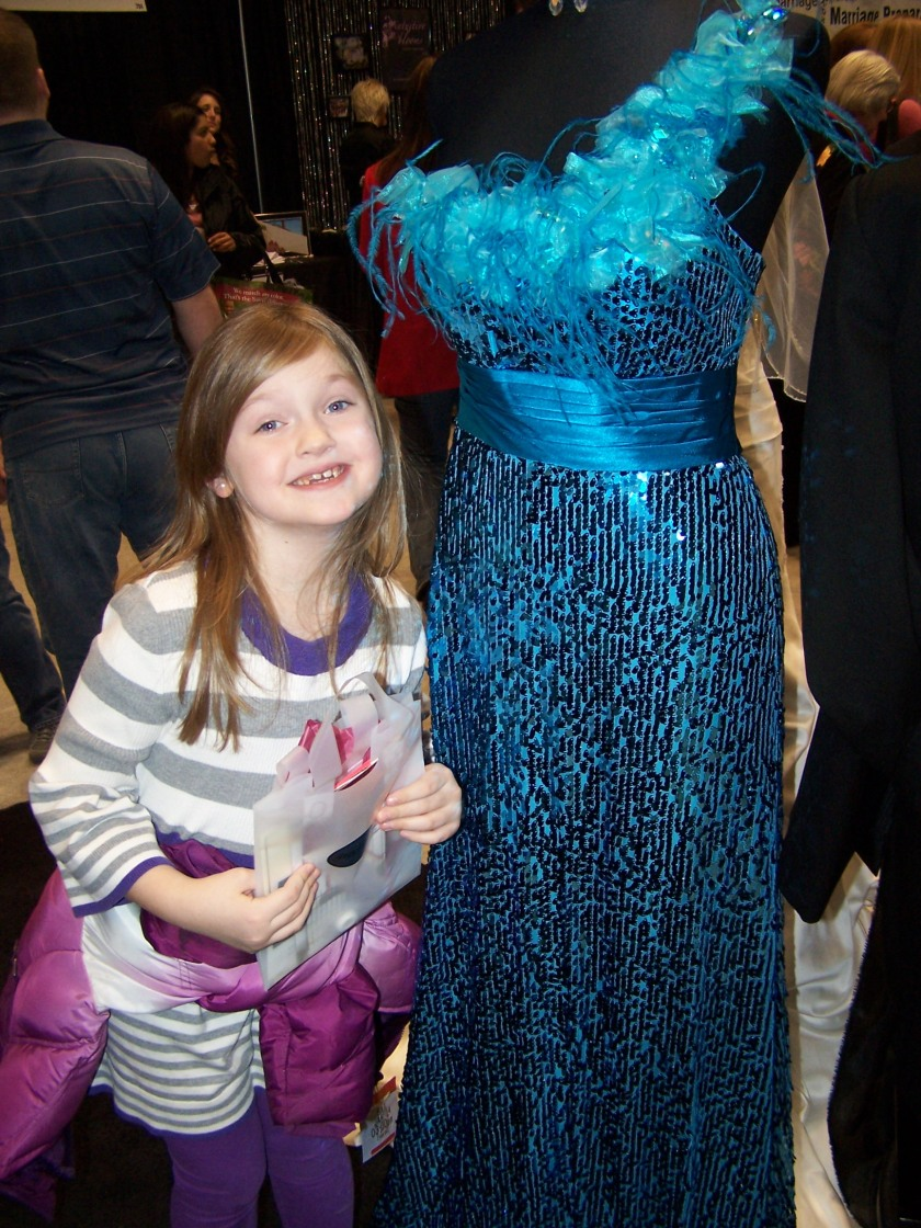 Madisen next to her favorite dress