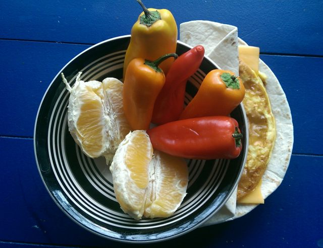 Breakfast wrap - 2 eggs, 1 slice sharp cheddar, tortilla; oranges, sweet peppers
